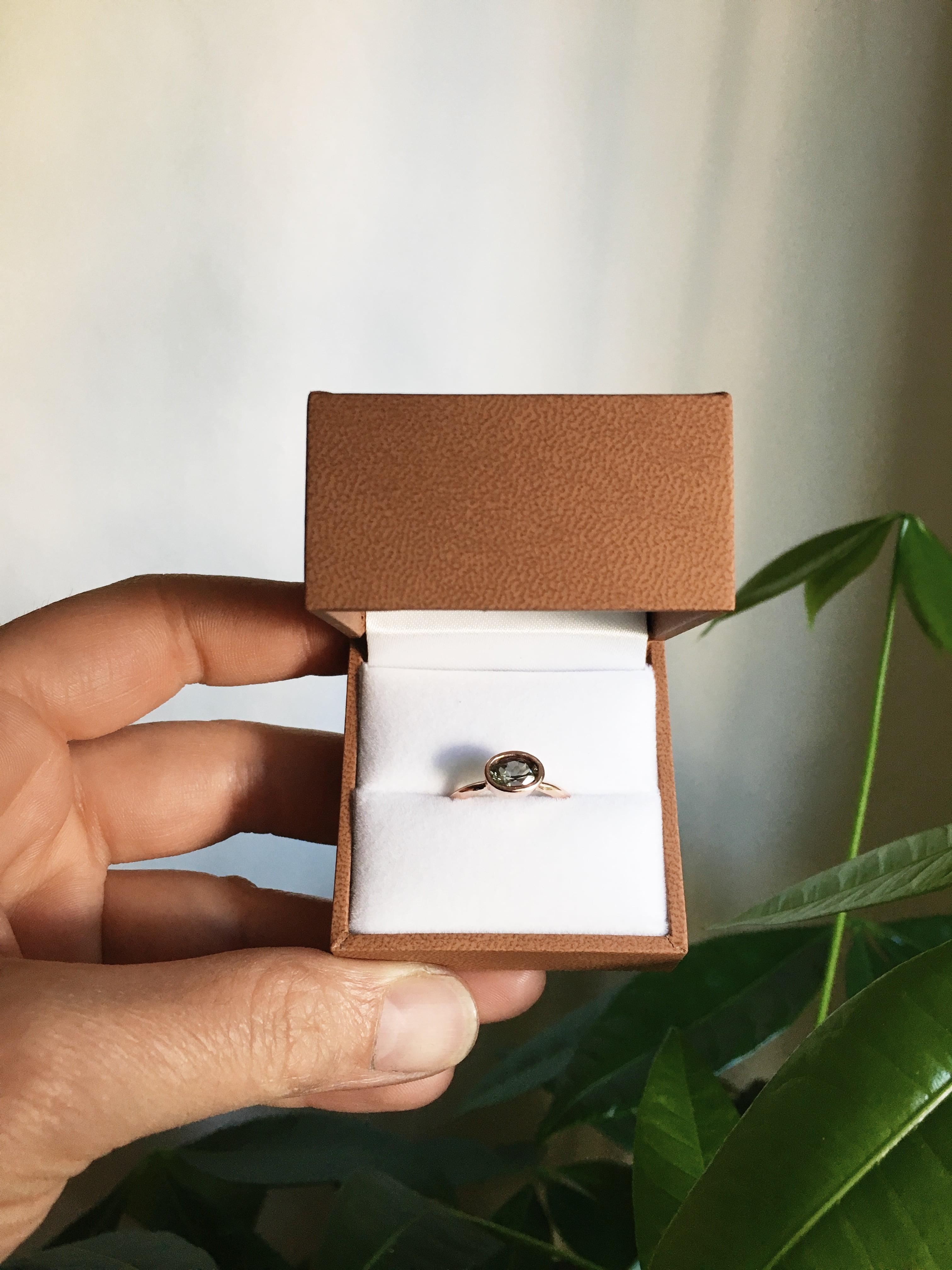 Oval Blue Oregon sunstone rose gold engagement ring